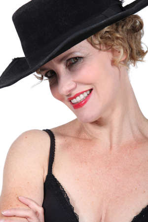 30 40: Smiling woman in black hat and bra