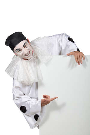 harlequin clown in disguise: Harlequin pointing white panel