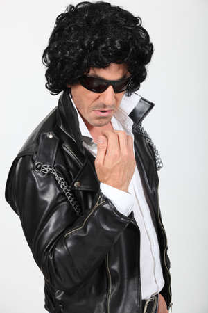 Man dressed as a rock-star photo
