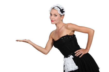 Woman in french maid fancy dress costume photo