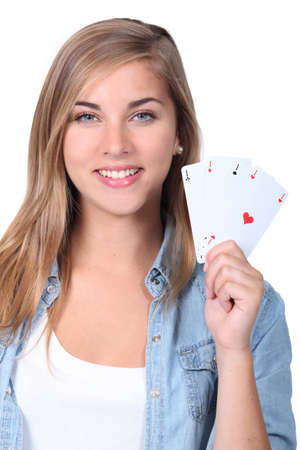 teens playing: Young girl holding playing cards