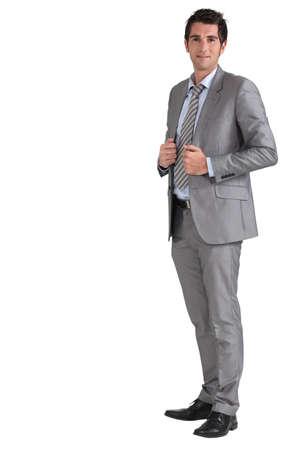 30 to 40: Businessman holding jacket