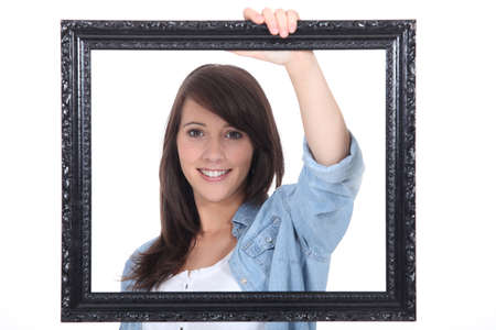 confiding: teenage girl behind a painting frame