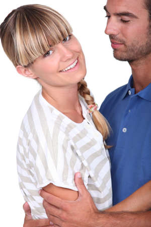 Happy young couple holding each other Stock Photo - 16471990