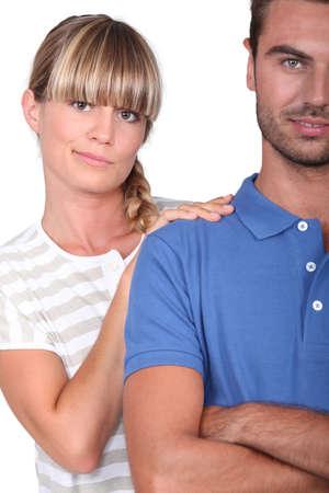 incertitude: An unsure woman touching her husband