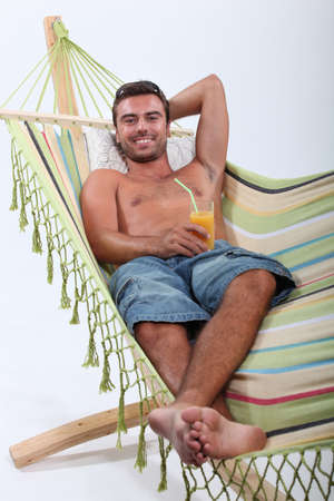 man lying in a hammock Stock Photo - 16471956