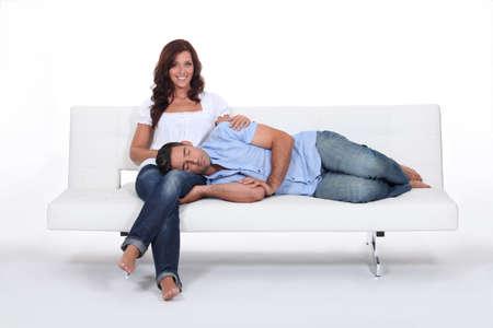 Sleeping man with his head on his girlfriend photo