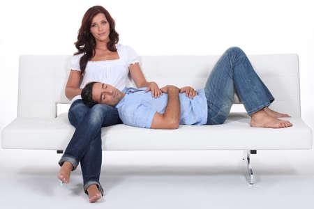 Man resting on his girlfriend lap Stock Photo - 16472198