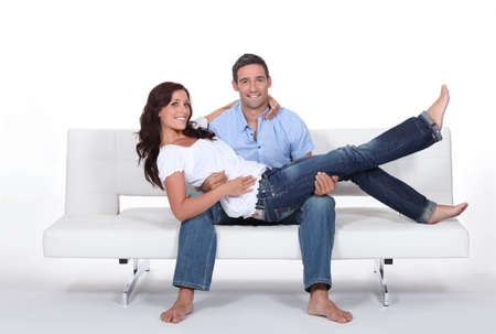 white pants: Couple on a couch