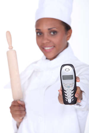 female chef holding a phone Stock Photo - 16472317