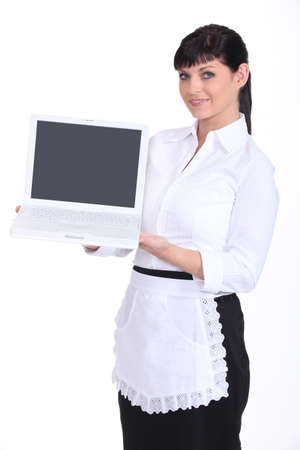 Waitress holding a laptop photo