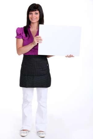 low blouse: brunette holding a canvas