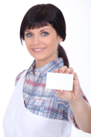 female butcher holding  a call card photo
