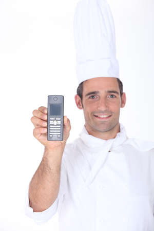 Chef holding up a telephone Stock Photo - 16472264