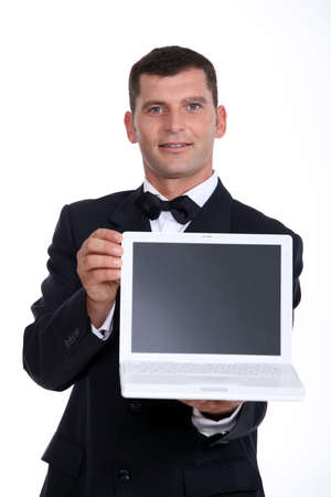minicomputer: Man presenting laptop