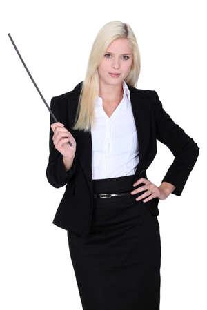 straight jacket: Woman with baton Stock Photo
