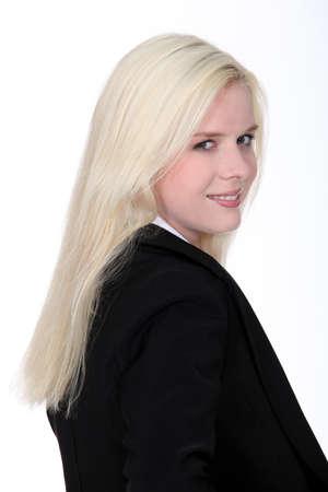 blonde woman wearing a dressy black suit Stock Photo - 16472092