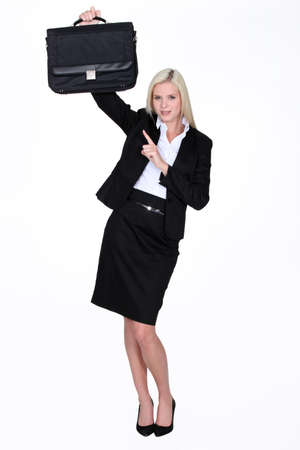 Woman pointing to briefcase photo