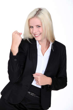 Excited blond businesswoman photo