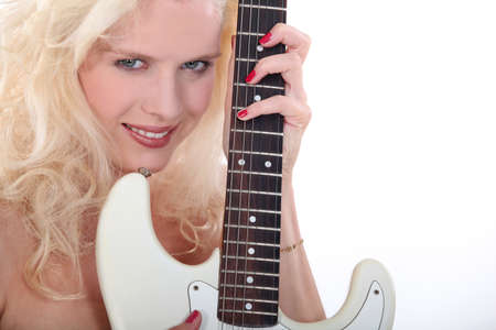 Woman with her guitar Stock Photo - 16472080
