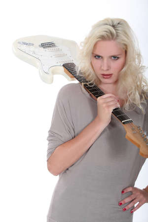 platinum hair: female singer posing with electric guitar Stock Photo