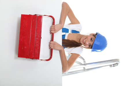chirpy: Pretty young woman with a red toolbox and a board left blank for your image