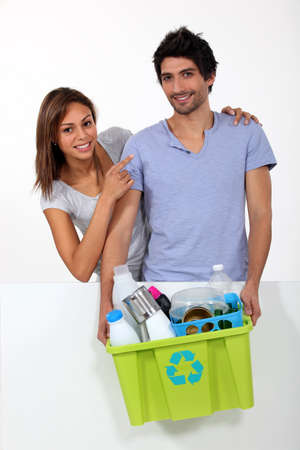 Couple taking out the recycling Stock Photo - 16471954