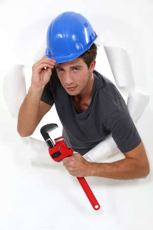 Laborer passing through a paper wall Stock Photo - 16472115