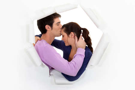 forehead: Man kissing girlfriend on forehead