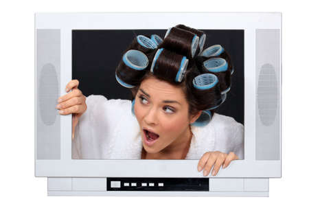 Woman escaping from television set Stock Photo - 16471994