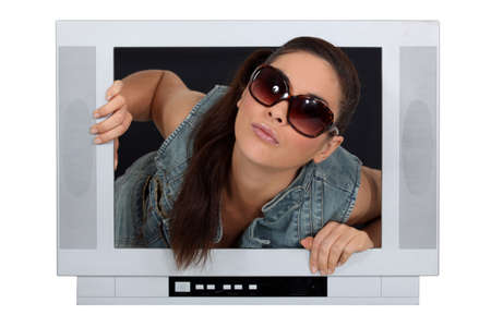 egoistic: Woman coming out of a television screen