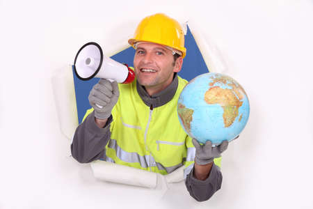 Builder with a loudspeaker and a globe photo