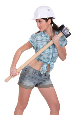 sexy construction worker: Sexy construction worker with a sledgehammer