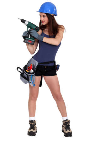 hard working woman: Sexy builder with drill