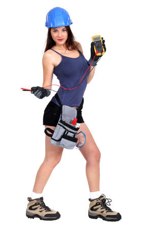 multimeter: sexy female electrician holding a measurement tool