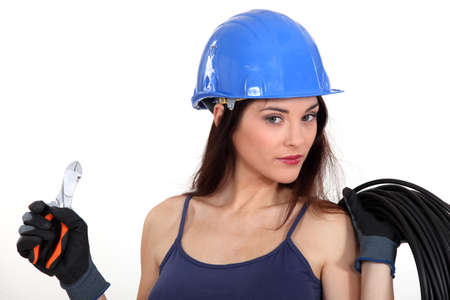 qualified worker: beautiful female electrician