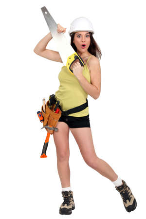 Woman holding handsaw Stock Photo - 16472379