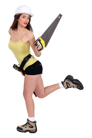handsaw: Attractive female builder with hand saw