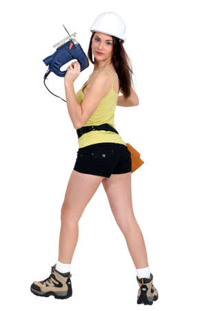 sexy woman holding a drill photo