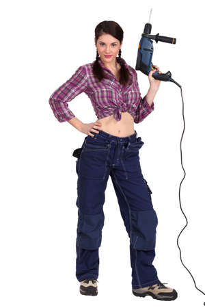 Sexy woman holding an electric screwdriver Stock Photo - 16472314