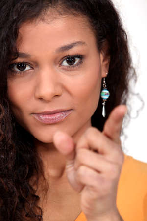 Afro-American woman pointing at you photo
