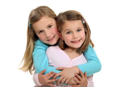 hairclip: Two sisters hugging  Stock Photo