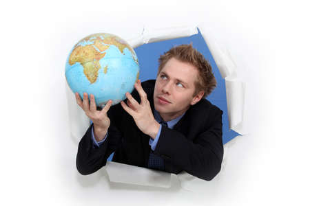 Man holding globe Stock Photo - 16472300