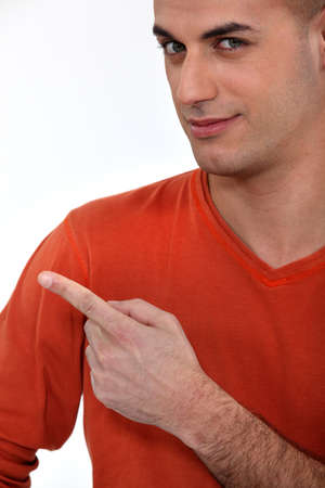 Young man pointing his finger Stock Photo - 16472022