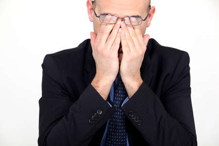 Businessman rubbing his eyes photo