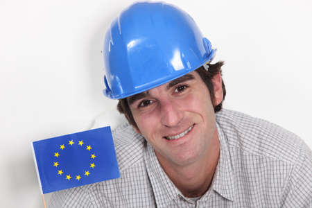 Smiling laborer with European flag photo
