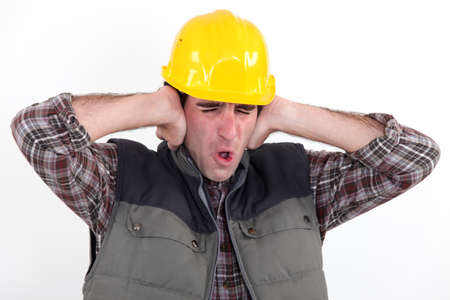 A construction worker covering his ears Stock Photo - 16471960