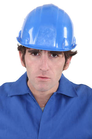 Portrait of a frowning construction worker Stock Photo - 16472138