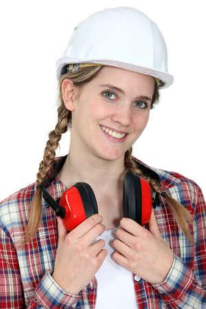 craftswoman: young craftswoman wearing earphones
