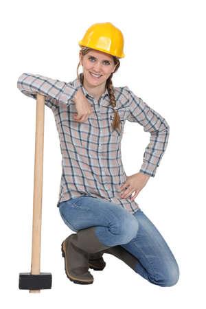 famale: Famale laborer kneeling Stock Photo